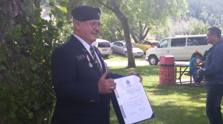 John Scott with his Medal of Good Citizenship from the Province of BC.