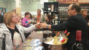 A Save-on-Foods employ serves up a wine taster at the Spruceland store